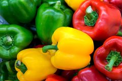 Red and yellow and Green sweet peppers. Pile Three sweet peppers on a wooden background, Cooking vegetable salad . Colorful sweet bell peppers, natural stock photography