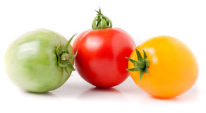 Red yellow and green tomatoes  on white background Royalty Free Stock Image