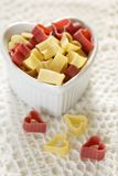Red and yellow heart-shaped pasta in a bowl Stock Photography