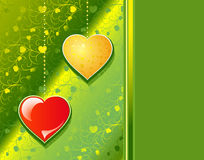 Red and yellow Hearts on a green patten background Royalty Free Stock Photography