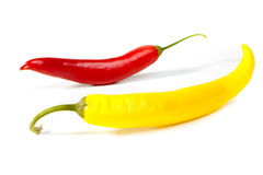 Red and yellow hot chili peppers. On white royalty free stock image