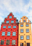 Red and Yellow iconic buildings on Stortorget Royalty Free Stock Images