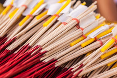 Red and yellow incense sticks Stock Photography