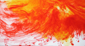 Red and yellow ink in water Royalty Free Stock Images
