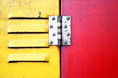Red and yellow iron door Stock Photography
