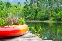 Summer Days - Kayak on pier with lake and trees Royalty Free Stock Photo