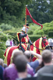 Red & yellow knight in crowd Royalty Free Stock Photo
