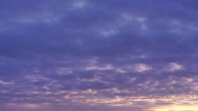 Impressive sky with red and yellow light of rising sun suffuses dark blue clouds at morning stock footage