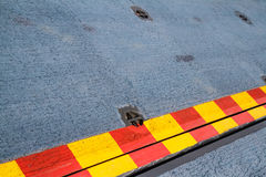 Red yellow line on the steel floor. Royalty Free Stock Image
