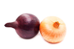 Red and yellow onion. On a white background close up Royalty Free Stock Photo