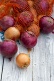 Red and yellow onion on wood Royalty Free Stock Photography