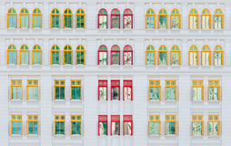 Red and yellow open windows on classical building Royalty Free Stock Photos