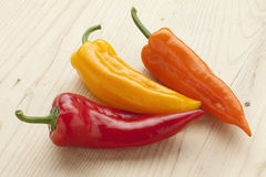 Red, yellow and orange bell peppers Stock Photography