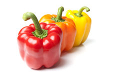Red Yellow and Orange Bell Peppers on Isolated Whi Stock Photos