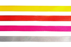 Red, yellow, orange, blue shiny gradient curling ribbons for design. Royalty Free Stock Photography
