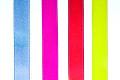 Red, yellow, orange and blue shiny gradient curling ribbons Royalty Free Stock Photo