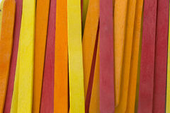 Red,Yellow and Orange colored popsicle sticks background. This is a photograph of Red,Yellow and Orange colored popsicle sticks background royalty free stock photos