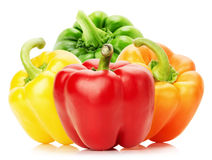 Red, yellow, orange and green pepper isolated on the white backg Royalty Free Stock Image