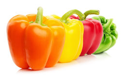 Red, yellow, orange and green pepper isolated on the white backg Royalty Free Stock Images