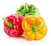 Red, yellow, orange and green pepper isolated on the white backg Stock Photography