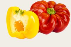 Red, yellow, orange, l peppers on white background Stock Photo