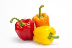 Red yellow orange pepper  on white background Royalty Free Stock Photos