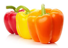 Red, yellow and orange peppers isolated on the white background Stock Photography