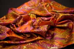 Red, yellow, orange tender colored textile, elegance rippled material Stock Photos