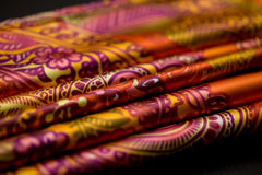 Red, yellow, orange tender colored textile, elegance rippled material Royalty Free Stock Photos