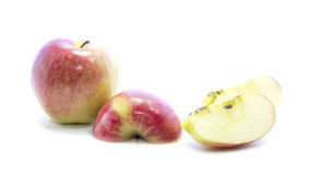 Red yellow organic apple half and quarter sliced with raw Stock Photo