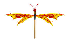Red and yellow paint made dragonfly Royalty Free Stock Photo