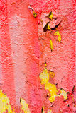 Red and yellow peeling paint Stock Images