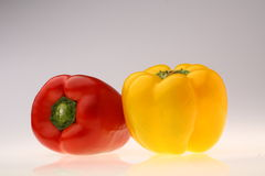 Red and Yellow Pepper. Close-up of fresh red and yellow pepper on white background Royalty Free Stock Images