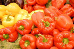 Red and yellow pepper at market Stock Photos