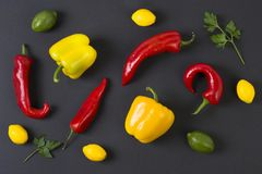 Red and yellow peppers on a black background. Dietary food. Vegetables on a black background.  Peppers on the table. Red and yellow peppers on a black Royalty Free Stock Photos