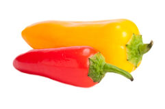 Red and yellow peppers on isolating background. Fresh, bright red and yellow peppers on white, isolating background Stock Photo