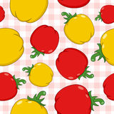 Red & Yellow Peppers Pattern on Tablecloth. A seamless pattern with red and yellow peppers on a checkered picnic tablecloth background. Useful also as design Royalty Free Stock Image