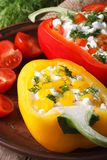 Red and yellow peppers stuffed with cottage cheese vertical Royalty Free Stock Photos