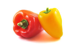 Red and yellow peppers on a table with a white background Stock Photo
