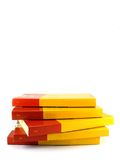 Red and yellow pile. Pile of books isolated on white Royalty Free Stock Photo