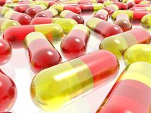 Red and yellow pills Royalty Free Stock Photos