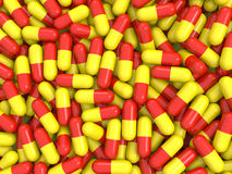 Red and yellow pills background. Red and yellow capsule shaped pills background. High quality rendering stock illustration