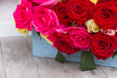Red, yellow  and pink  roses  on table Stock Photography