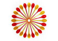 Red and yellow plastic spoons Royalty Free Stock Photography