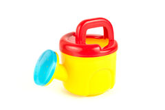 Red and yellow plastic toy watering can Royalty Free Stock Image