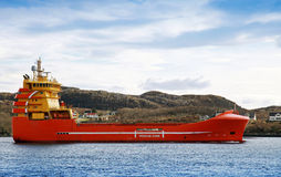 Red and yellow platform supply ship Stock Photos