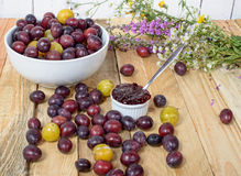 Red and yellow plums on a wooden table Royalty Free Stock Image