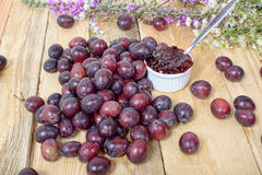 Red and yellow plums on a wooden table Royalty Free Stock Images