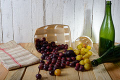 Red and yellow plums on a wooden table Royalty Free Stock Photography