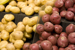 Red and yellow potatoes in grocery store stock photo